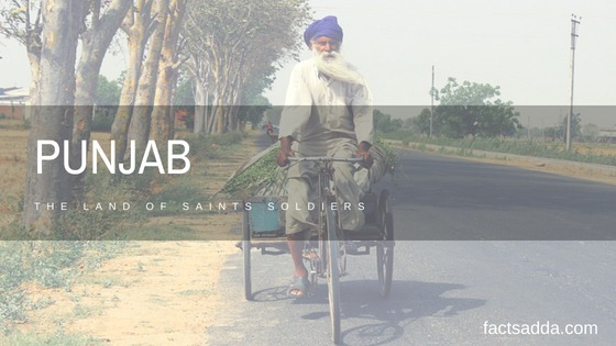 A man ride trycycle in a road of punjab